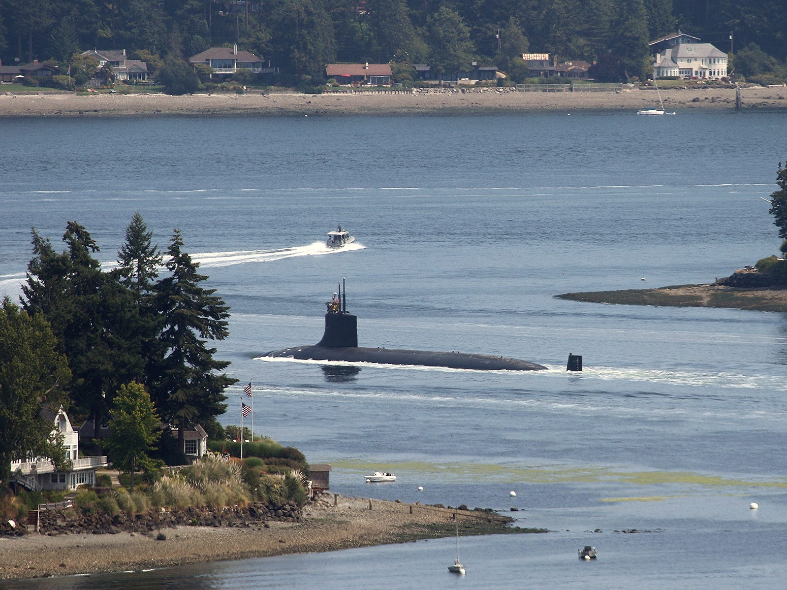 A submarine goes through Rich Passage between Bainbridge Island and Port Orchard on Tuesday afternoon after it leaves Bremerton.