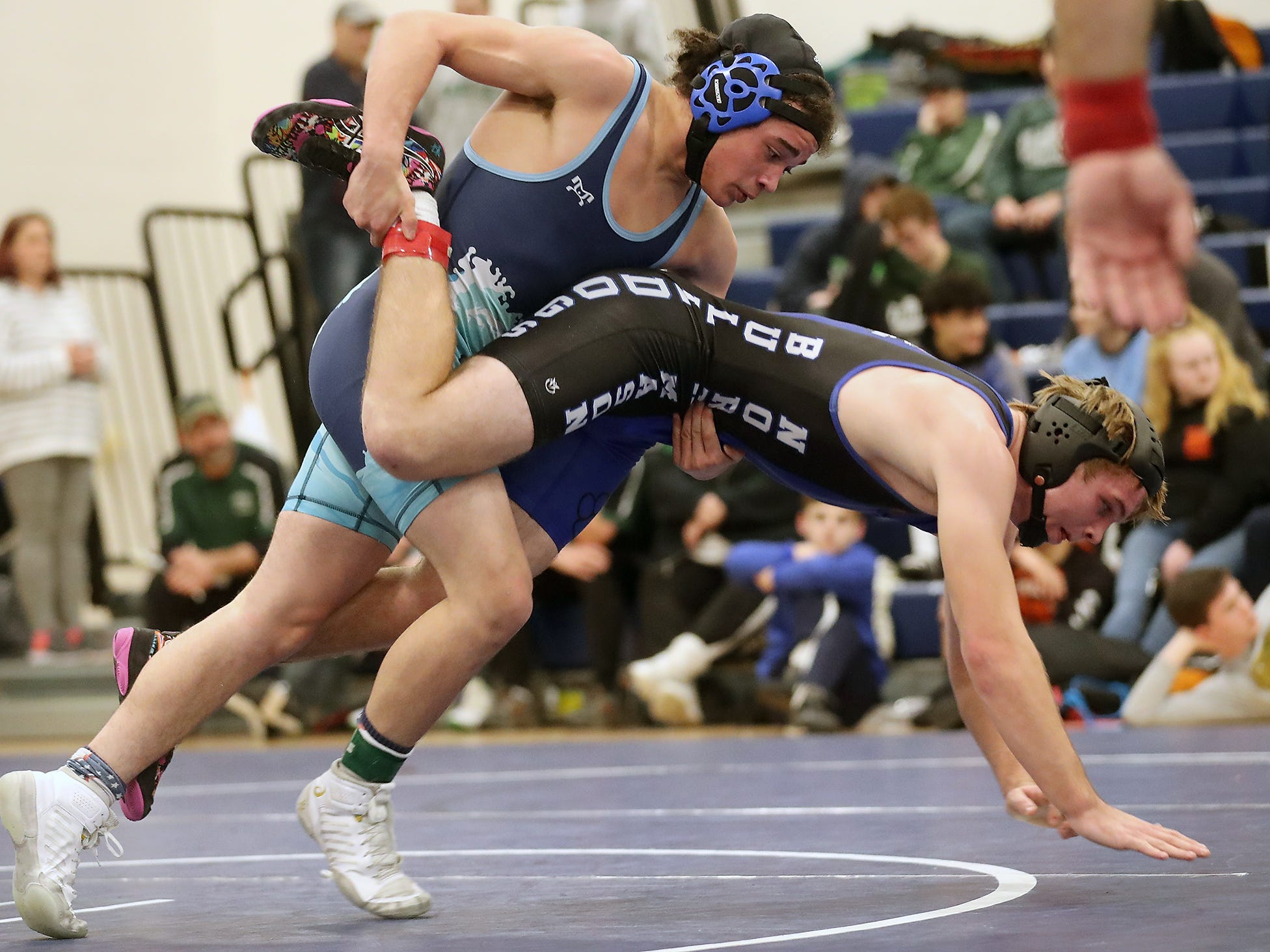 North Mason's Daniel Pulley and Gig Harbor's Trevor Zeitner grapple for the first place finish in the 160-pound weight class at the North Mason Classic in Belfair on Saturday, December 22, 2018.