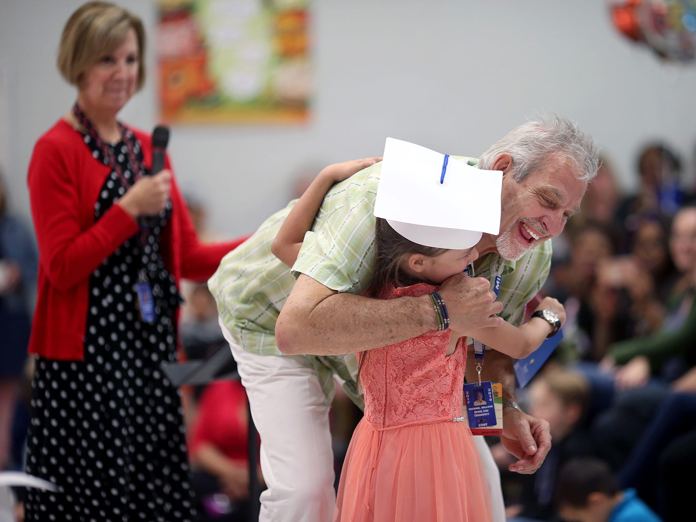 Armin Jahr Elementary School principal Mike Sellers gets a hug after a graduation ceremony for the kindergartners on the last day of school on June 15, 2018. He is retiring after 43 years in eductaion, along with kindergarten teacher Vicki Golmstad behind him.