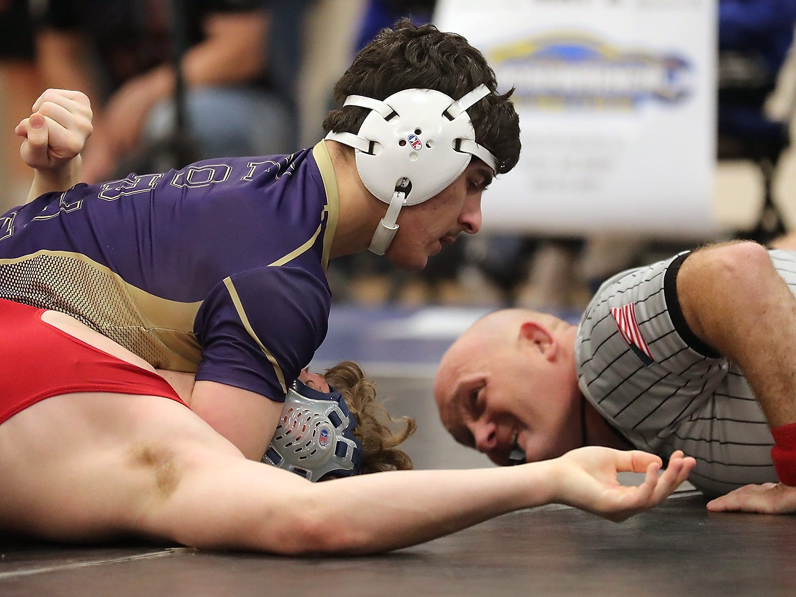 North Kitsap's Nouh Hammou (top) pins Port Townsend's Kyle Caldwell in the finals for the 195-pound bracket at the North Mason Classic in Belfair on Saturday, December 22, 2018.