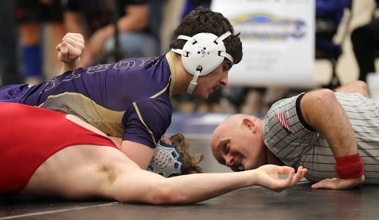 North Kitsap wrestler Nouh Hammou (top) pins Port Townsend's Kyle Caldwell in the 195-pound final Saturday at the North Mason Classic.