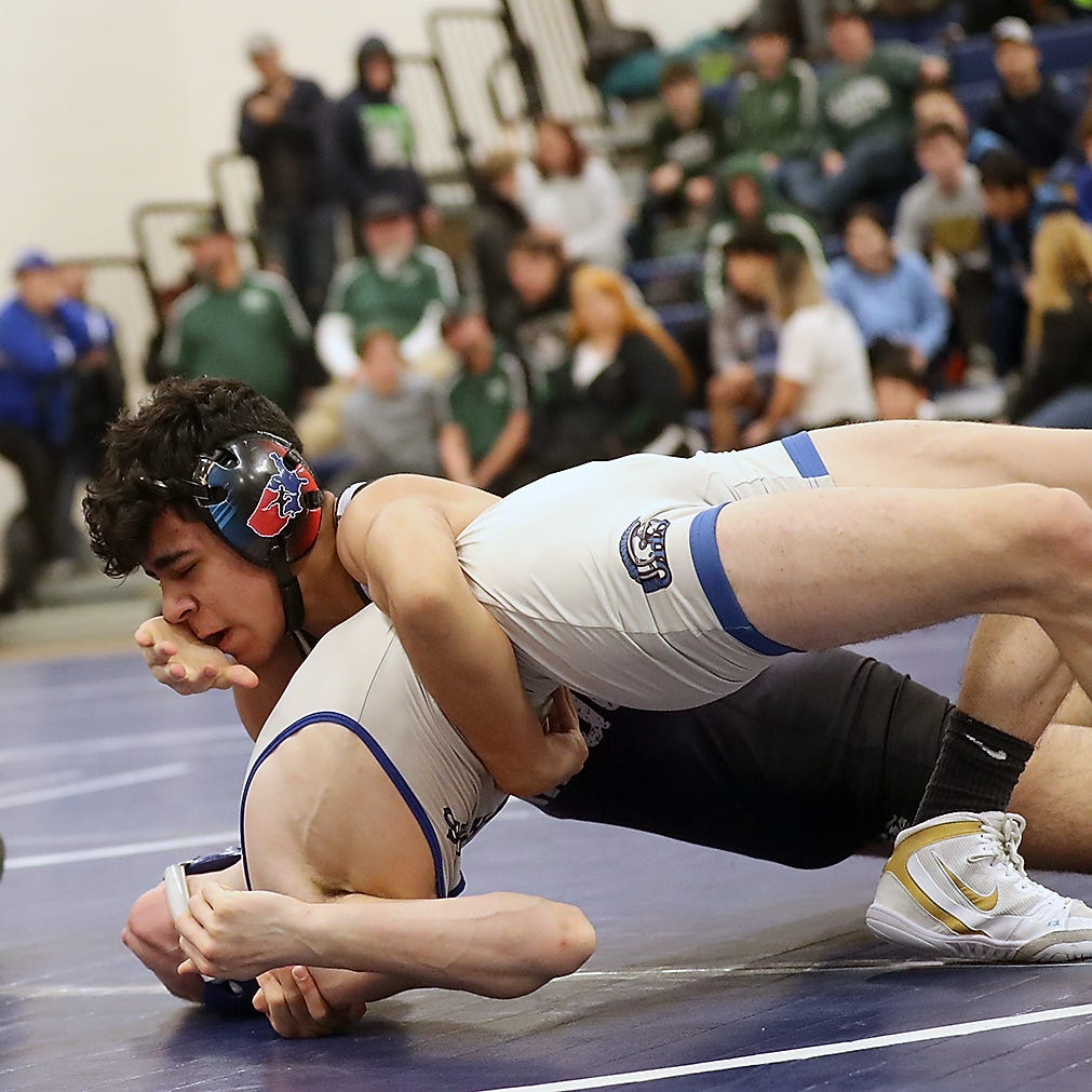 North Kitsap's Robert Gomez makes a statement on the mat
