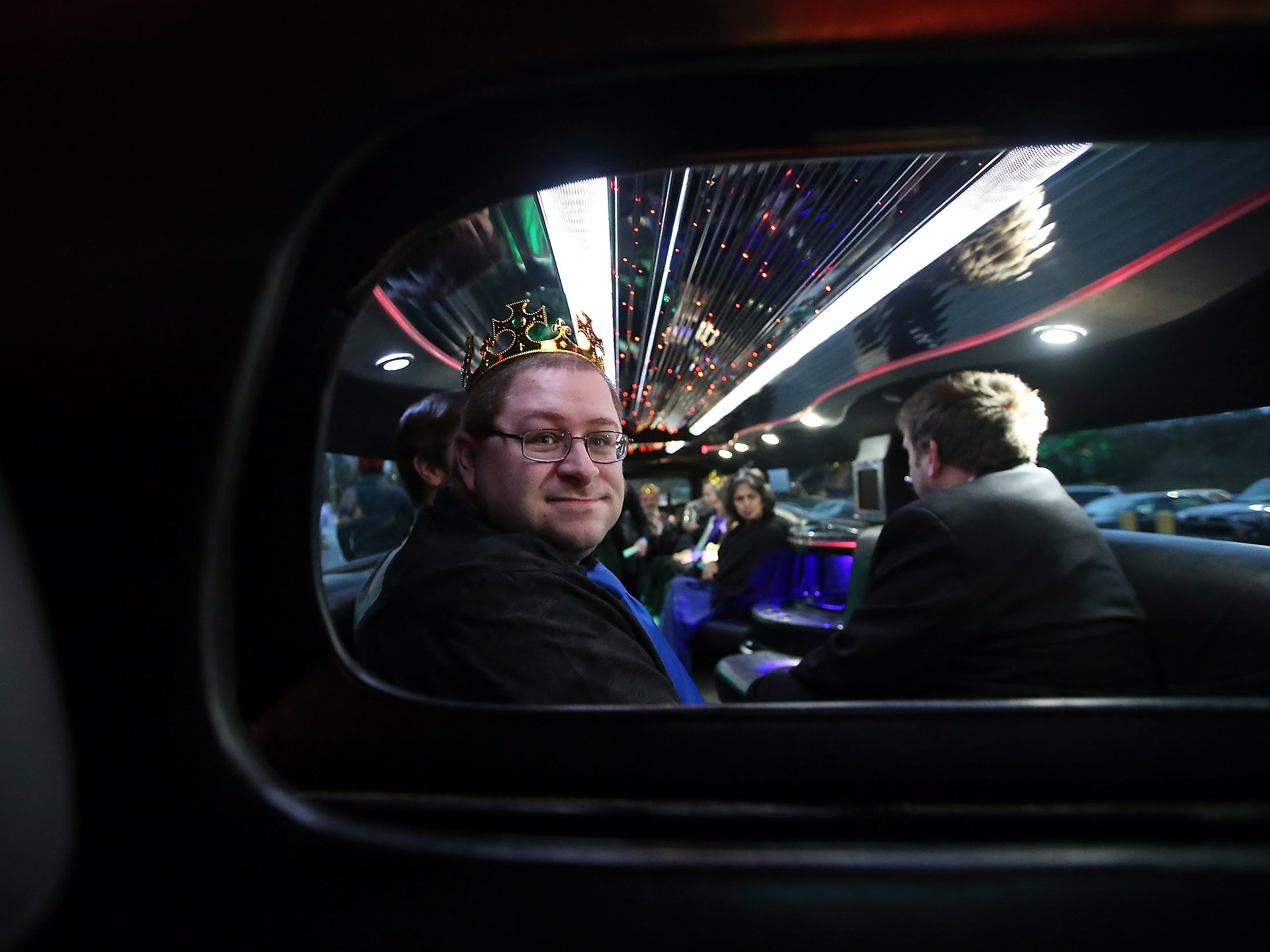 Prom attendee Robert Kondracki looks through the partition to the front of the limo as he and fellow partygoers get ready for a ride at the annual Night to Shine at the Kitsap Sun Pavilion on Friday, Feb. 9, 2018. Night to Shine is an annual prom experience for people with special needs was created and sponsored by the Tim Tebow Foundation and hosted locally by Newlife Church.