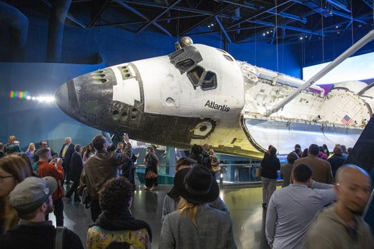 Guests see Space Shuttle Atlantis during the Constellation event at the Kennedy Space Center Visitor Complex on Friday, Dec. 21, 2018.