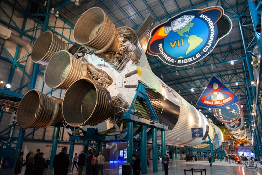 Constellation event guests get an astronaut-guided tour of the Saturn V rocket at the Kennedy Space Center Visitor Complex on Friday, Dec. 21, 2018. The event celebrated the Apollo 8 mission's 50th anniversary.