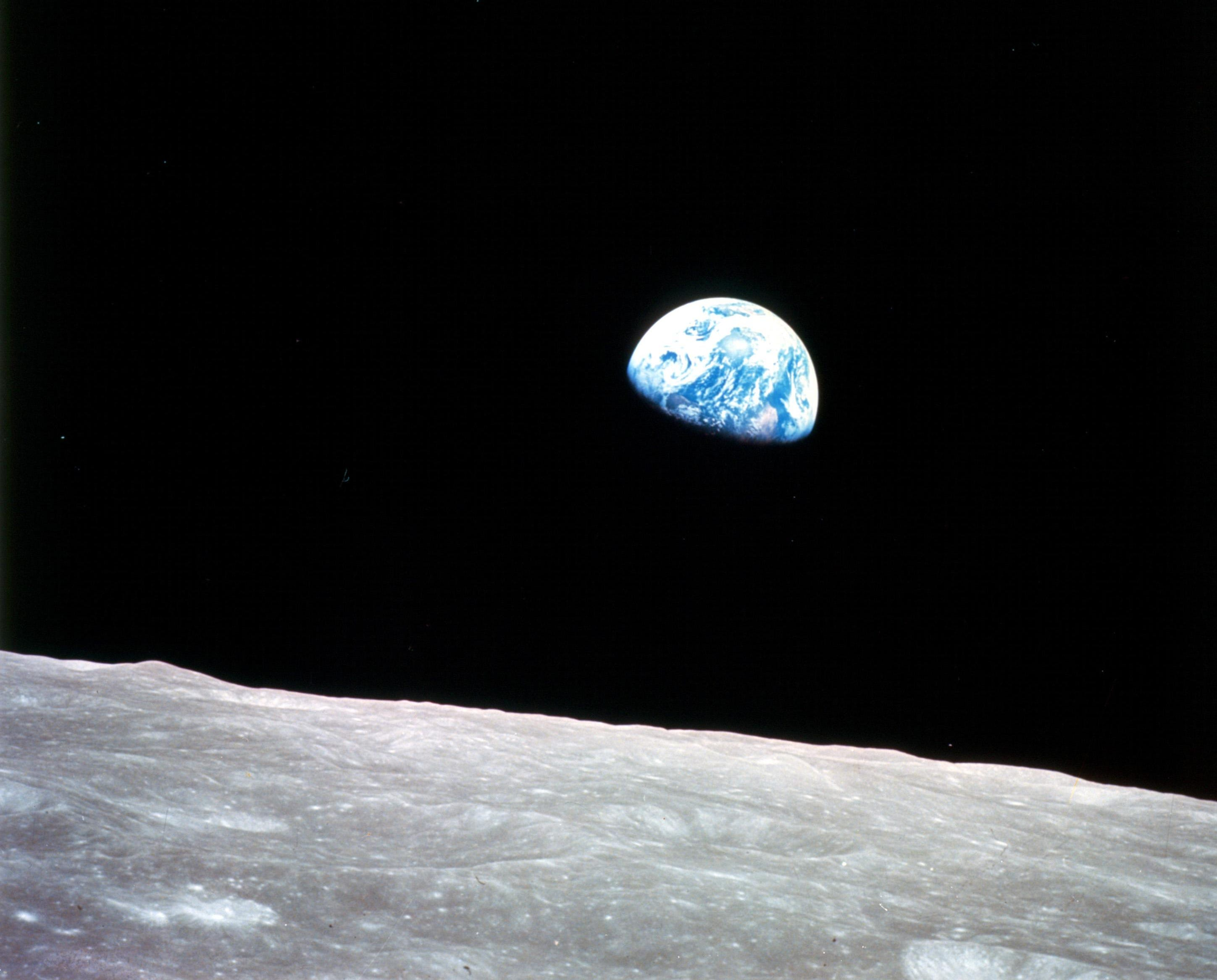"""The famous """"Earthrise"""" image captured by the Apollo 8 crew on Christmas Eve 1968. The mission was the first to send humans beyond low-Earth orbit."""
