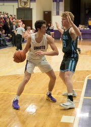 Unioto's Gabe McBee looks for an opening to pass Saturday night at Unioto High School. Adena defeated Unioto 55-53.