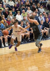 Former Unioto and current Adena guard Cade McKee drives the ball against Adena at Unioto High School in Chillicothe, Ohio.