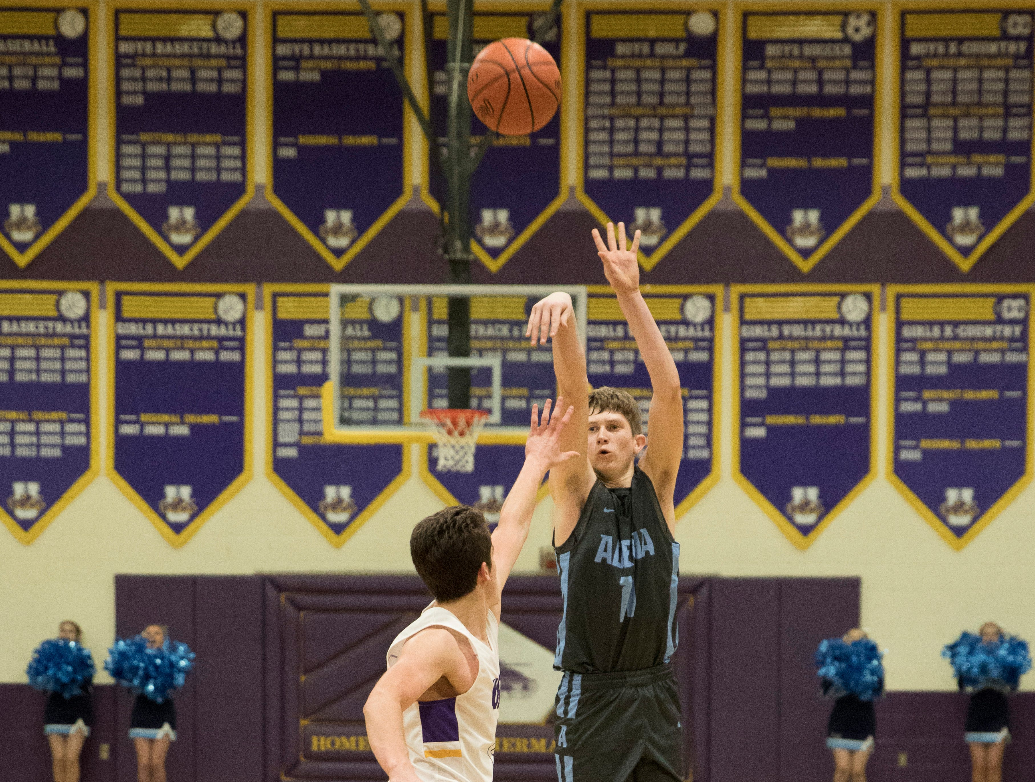 Adena's Logan Bennett makes a jump shot to score one of his 20 points Friday night against Unioto in Chillicothe, Ohio, and helping to clench Adena's sixth SVC win.