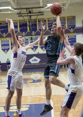 Adena's Preston Sykes puts up a shot during a 55-53 win over Unioto at Unioto High School in Chillicothe, Ohio.