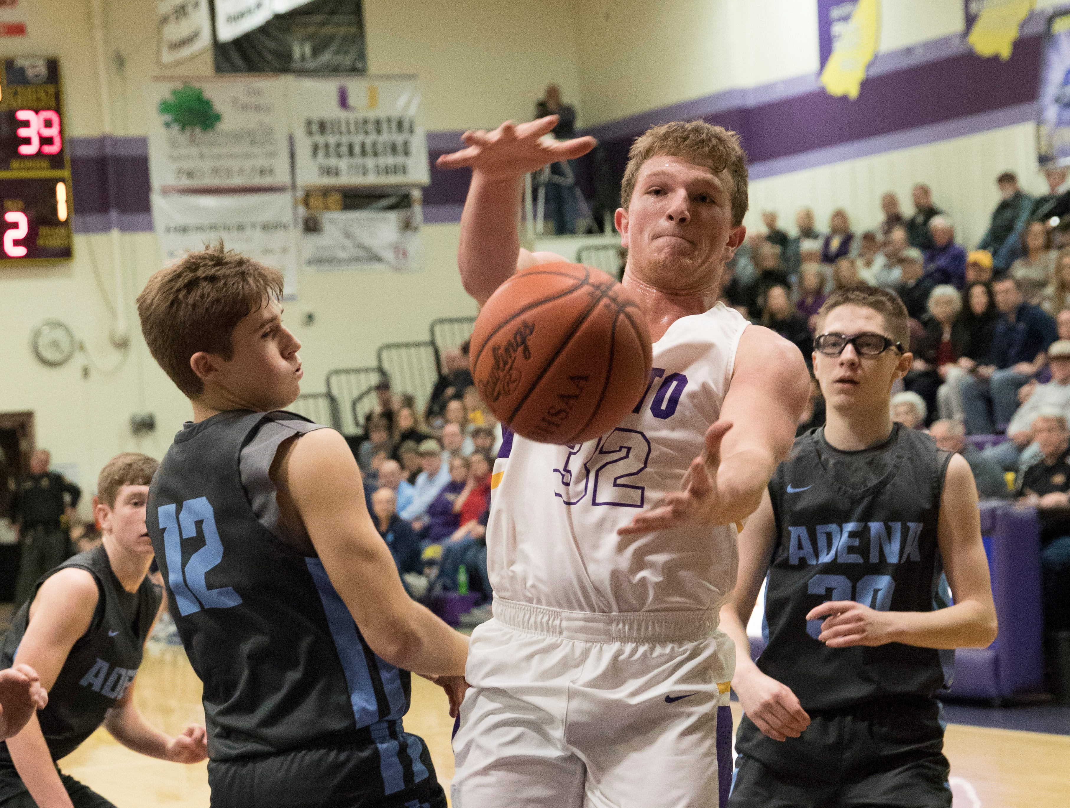 Unioto senior Chance Smith attempts to grab the ball to keep it in play during a heated game against Adena Saturday night in Chillicothe, Ohio, giving Adena its sixth SVC win.