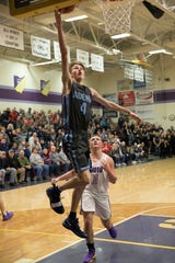 Adena's Jarrett Garrison lays the ball up during a 55-53 win over Unioto at Unioto High School in Chillicothe, Ohio.