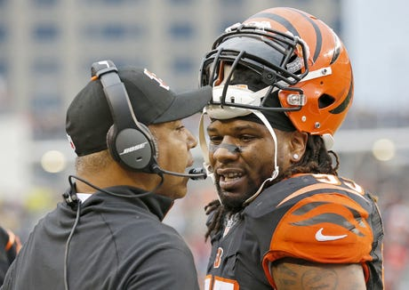 Cincinnati Bengals head coach Marvin Lewis talks with outside linebacker Vontaze Burfict (55) after another penalty in the fourth quarter of the NFL Week 14 game between the Cincinnati Bengals and the Pittsburgh Steelers at Paul Brown Stadium in downtown Cincinnati on Sunday, Dec. 13, 2015. The Bengals fell to 10-3 with a 33-20 loss to the Steelers.