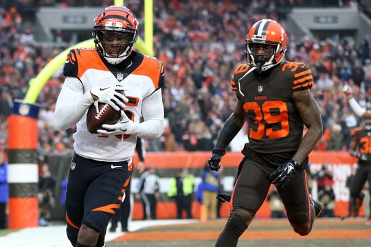 Cincinnati Bengals wide receiver John Ross (15) catches a touchdown pass as Cleveland Browns cornerback Terrance Mitchell (39) in the fourth quarter of a Week 16 NFL football game, Sunday, Dec. 23, 2018, at FirstEnergy Stadium in Cleveland. The Cleveland Browns won 26-18.