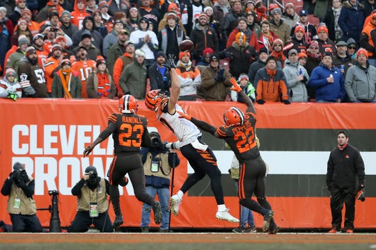 Cincinnati Bengals tight end C.J. Uzomah (87) catches a touchdown pass in the fourth quarter of a Week 16 NFL football game against the Cincinnati Bengals, Sunday, Dec. 23, 2018, at FirstEnergy Stadium in Cleveland. The Cleveland Browns won 26-18.