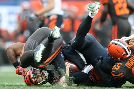 Cincinnati Bengals quarterback Jeff Driskel (6) is sacked in the second quarter of a Week 16 NFL football game, Sunday, Dec. 23, 2018, at FirstEnergy Stadium in Cleveland.