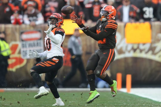 Cincinnati Bengals defensive back Brandon Wilson (40) defends as Cleveland Browns running back Duke Johnson (29) completes the catch in the fourth quarter of a Week 16 NFL football game, Sunday, Dec. 23, 2018, at FirstEnergy Stadium in Cleveland. The Cleveland Browns won 26-18.