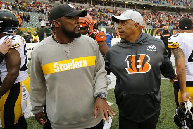 Pittsburgh Steelers head coach Mike Tomlin and Cincinnati Bengals head coach Marvin Lewis cross the field after breaking up players as a scuffle breaks out after the fourth quarter of the NFL Week 6 game between the Cincinnati Bengals and the Pittsburgh Steelers at Paul Brown Stadium in downtown Cincinnati on Sunday, Oct. 14, 2018. The Bengals and Steelers exchanged late touchdowns, with the Pittsburgh coming out on top, 28-21.