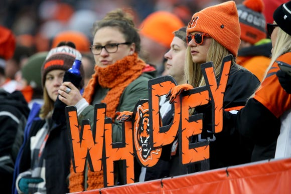 Cincinnati Bengals fans watch the game in the fourth quarter of a Week 16 NFL football game against the Cincinnati Bengals, Sunday, Dec. 23, 2018, at FirstEnergy Stadium in Cleveland. The Cleveland Browns won 26-18.