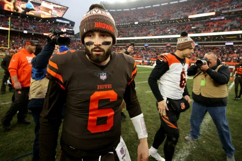 Cleveland Browns quarterback Baker Mayfield (6) walks off the field after shaking hands with Cincinnati Bengals quarterback Jeff Driskel (6), right, following the Week 16 NFL football game, Sunday, Dec. 23, 2018, at FirstEnergy Stadium in Cleveland. The Cleveland Browns won 26-18.