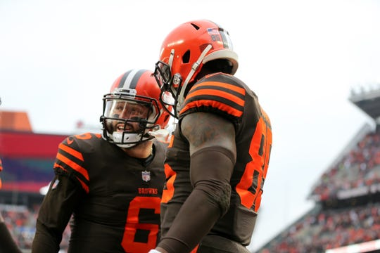 Cleveland Browns quarterback Baker Mayfield (6) congratulates Cleveland Browns tight end David Njoku (85) on his touchdown catch in the second quarter of a Week 16 NFL football game, Sunday, Dec. 23, 2018, at FirstEnergy Stadium in Cleveland.