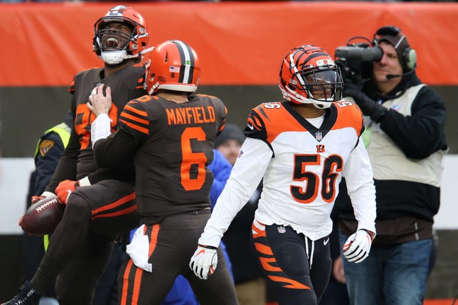 Cincinnati Bengals middle linebacker Hardy Nickerson (56) reacts after Cleveland Browns tight end Darren Fells (88) celebrates a touchdown catch with Cleveland Browns quarterback Baker Mayfield (6) in the second quarter of a Week 16 NFL football game, Sunday, Dec. 23, 2018, at FirstEnergy Stadium in Cleveland.