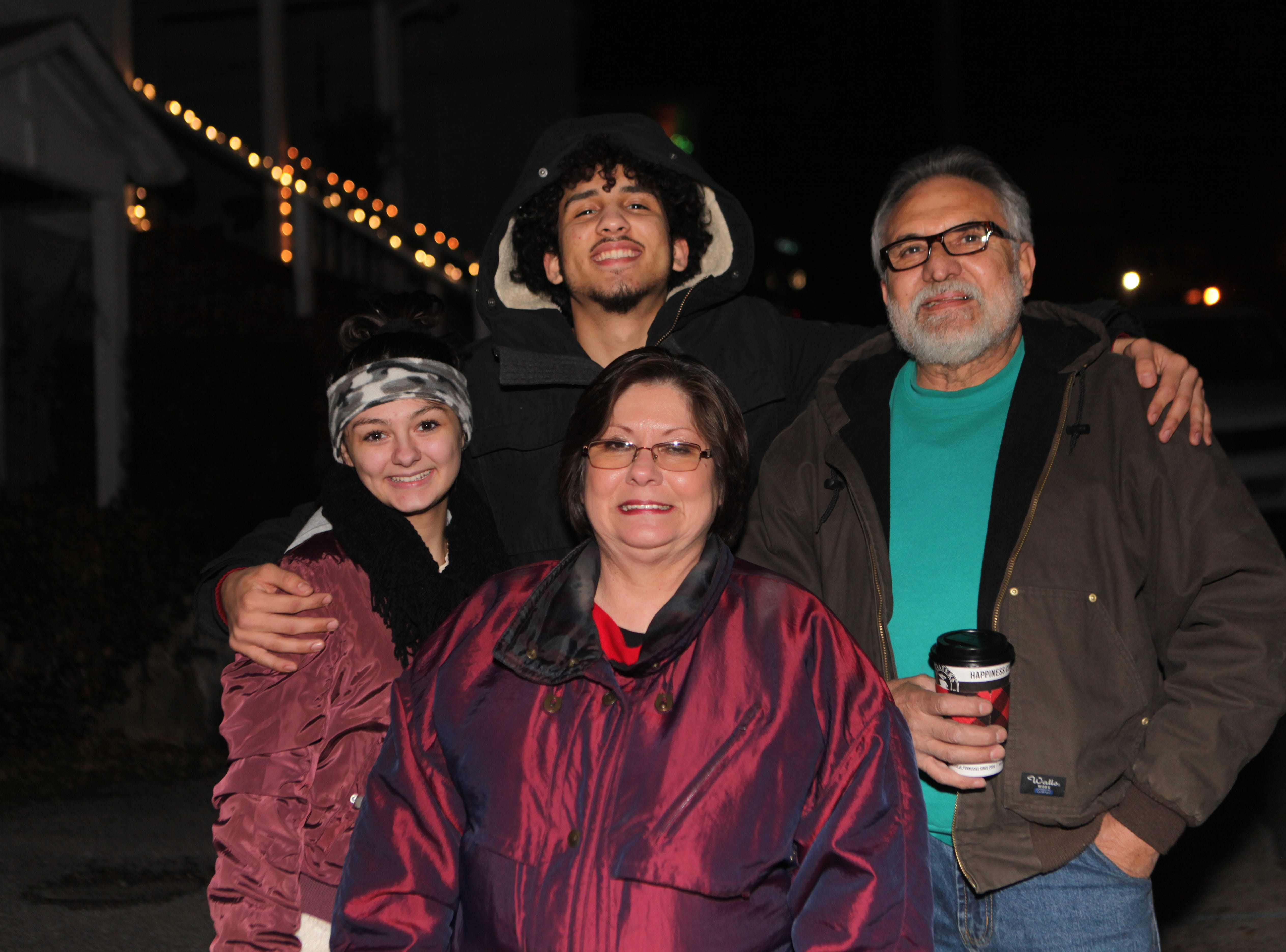 Abigail, Gloria and Mario Raygoza with Jebed Colon smile at the annual Illuminating Dog Hill event with candlelit luminaria Saturday, Dec. 22, 2018, in Clarksville, Tenn.