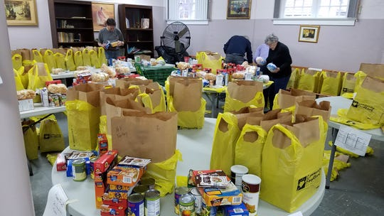 Volunteers at Star Fish Food Pantry in Plainfield gathered on Dec. 20 to pack Christmas dinner bags for more than 160 families in need.