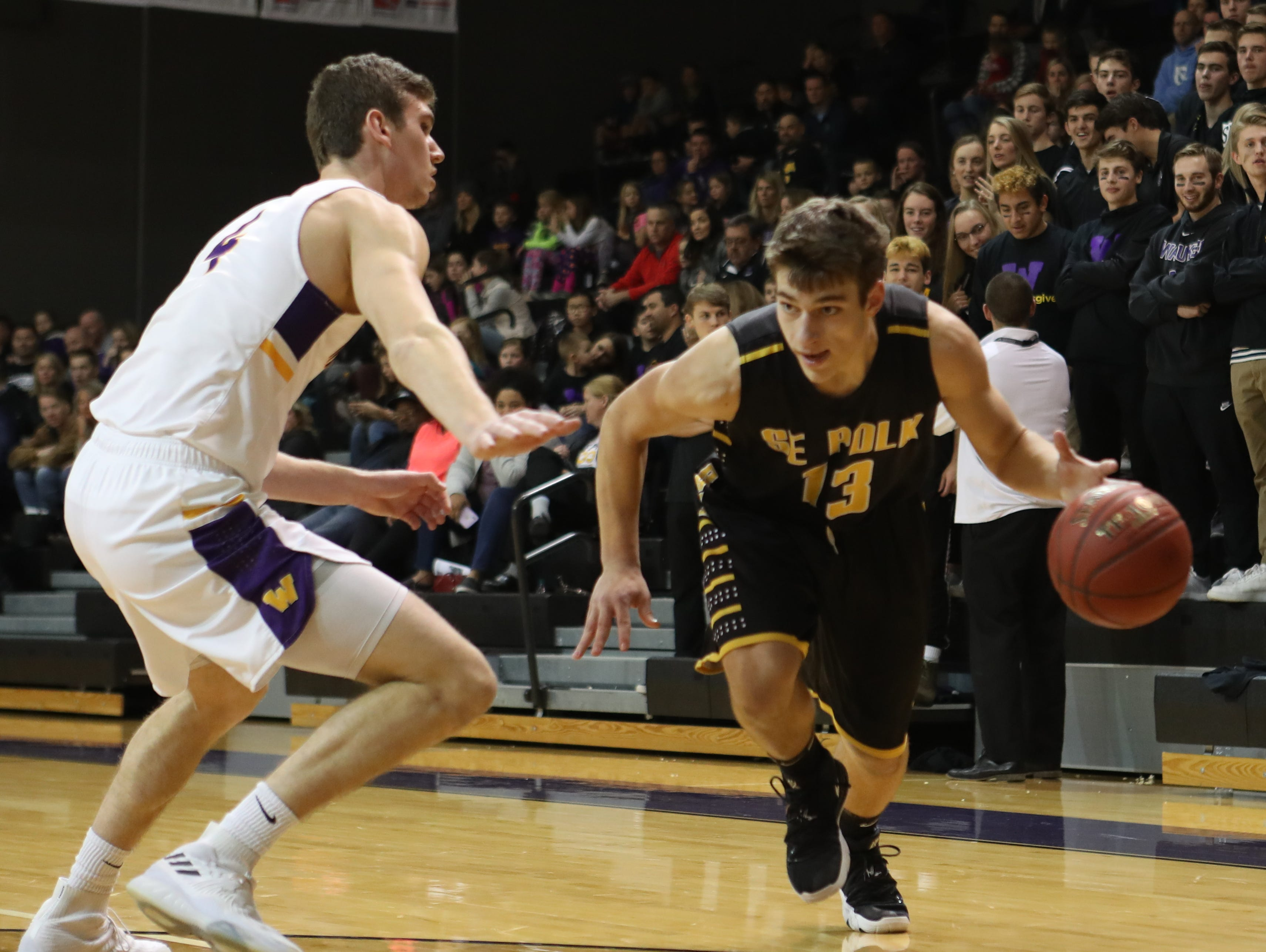 Dec 21, 2018; Waukee IA  USA; Waukee Warriors Dylan Jones (4) defends Southeast Polk Rams Dominic Caggiano (13)  at Waukee High School. Mandatory Credit: Reese Strickland-for the register