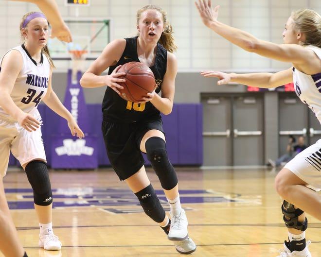 Southeast Polk's Grace Larkins (10) drives the lane against Waukee on Friday, Dec. 21, at Waukee High School. Southeast Polk won the game 74-41.