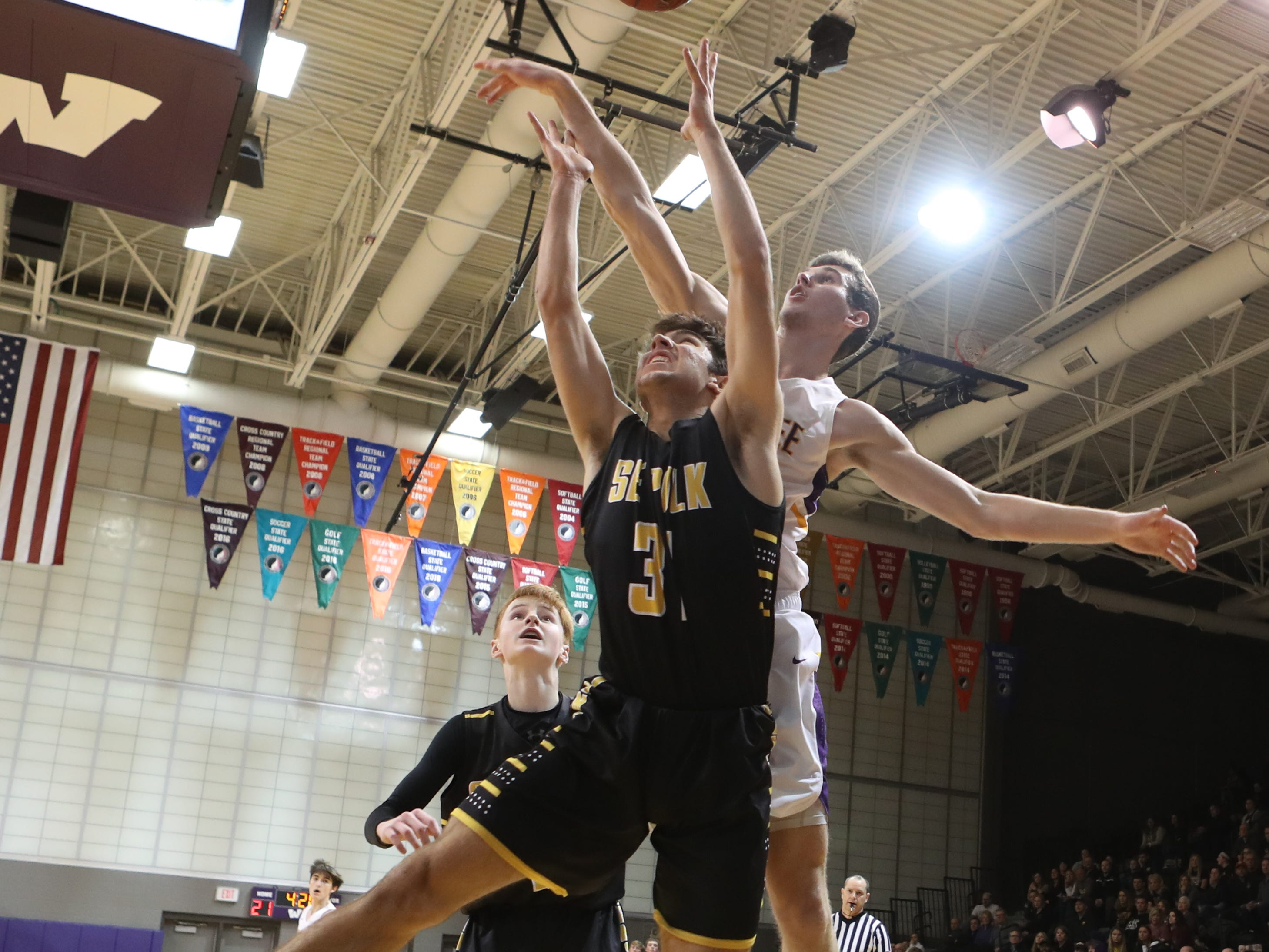 Dec 21, 2018; Waukee IA  USA;  Southeast Polk Rams Josiah Cole (31) is fouled by Waukee Warriors Dylan Jones (4) at Waukee High School. Mandatory Credit: Reese Strickland-for the register