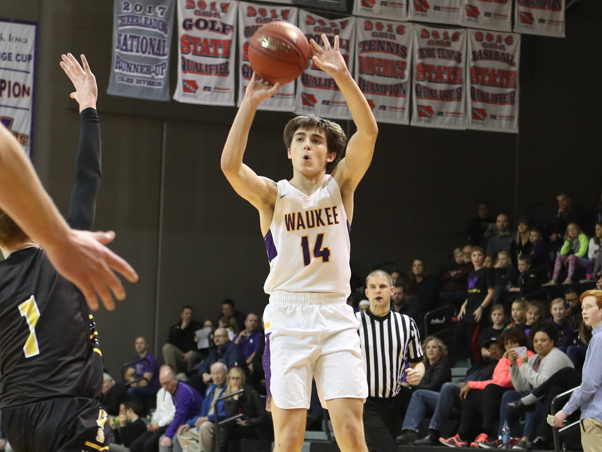 Dec 21, 2018; Waukee IA  USA;  Waukee Warriors Andrew Curran (14) shoots against the Southeast Polk Rams at Waukee High School. Mandatory Credit: Reese Strickland-for the register