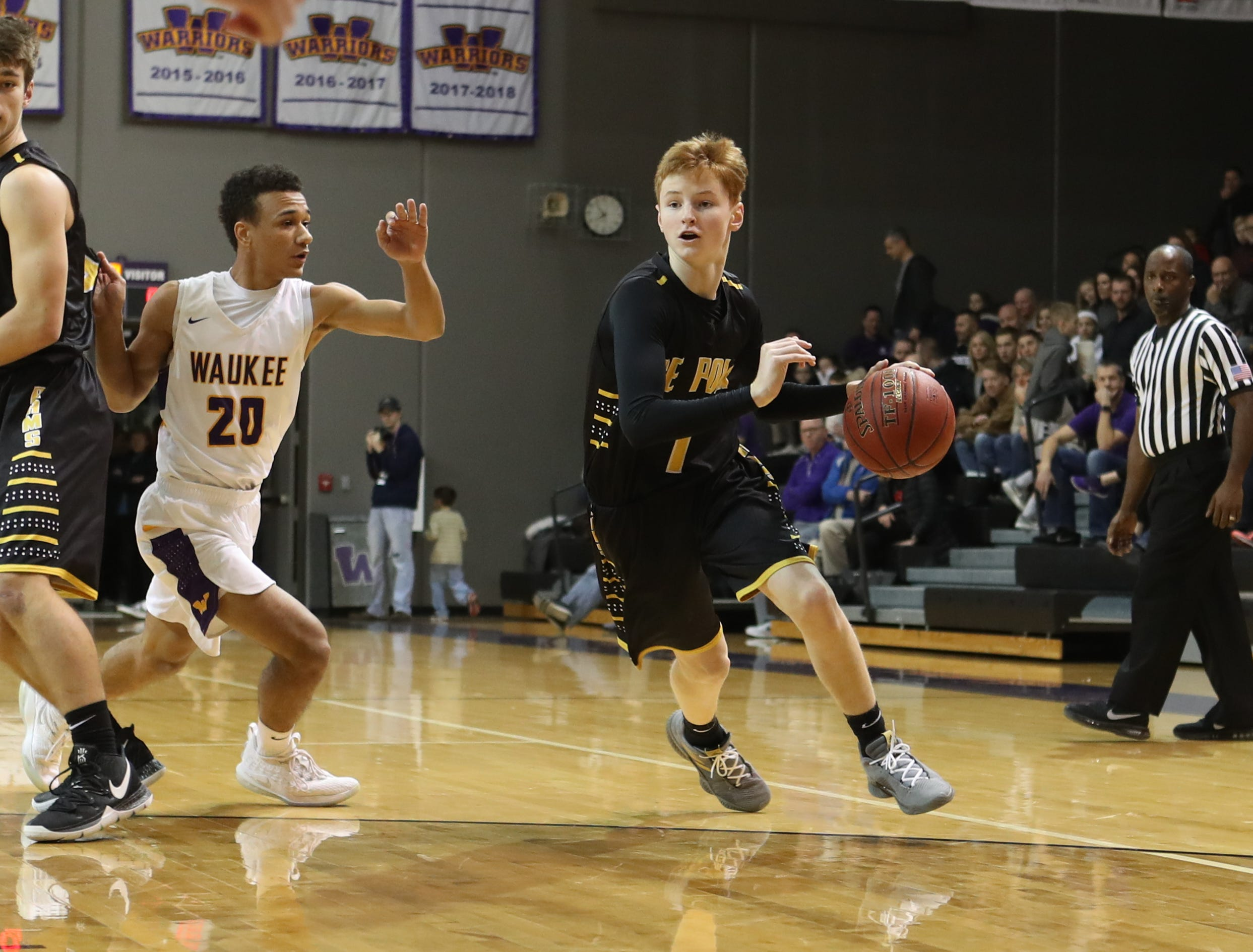 Dec 21, 2018; Waukee IA  USA; Southeast Polk Rams James Glenn (1) drives past Waukee Warriors Dante Jenkins (20) at Waukee High School. Mandatory Credit: Reese Strickland-for the register