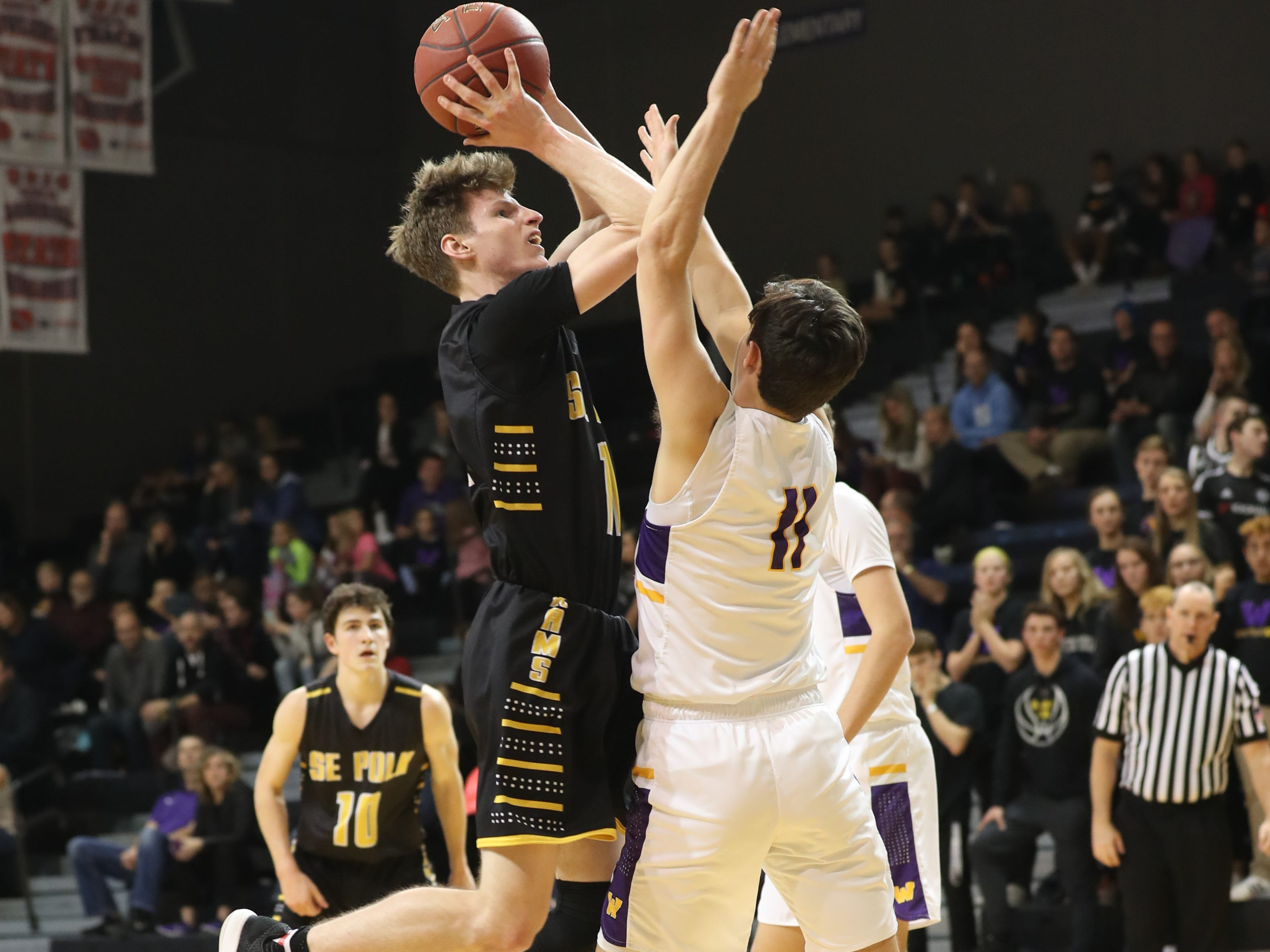 Dec 21, 2018; Waukee IA  USA; Southeast Polk Rams Sam Glenn (11) is defended by Waukee Warriors Noah Hart (11) at Waukee High School. Mandatory Credit: Reese Strickland-for the register