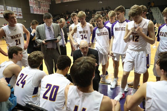Dec 21, 2018; Waukee IA  USA;  Waukee Warriors head coach Justin Ohl talks to his team during their game with the Southeast Polk Rams at Waukee High School. Mandatory Credit: Reese Strickland-for the register