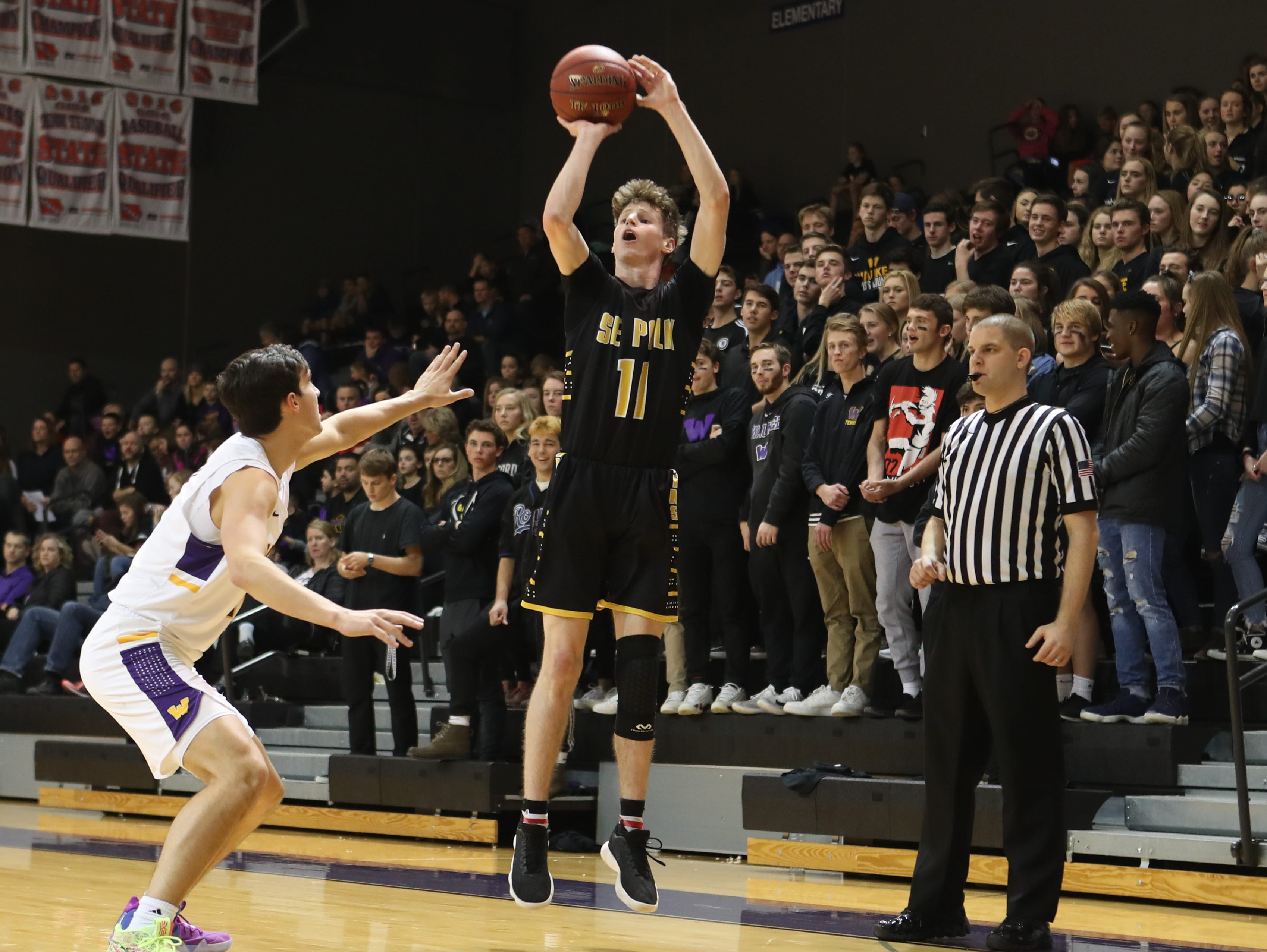 Dec 21, 2018; Waukee IA  USA; Southeast Polk Rams Sam Glenn (11) shoots a three point shot against the Waukee Warriors at Waukee High School. Mandatory Credit: Reese Strickland-for the register