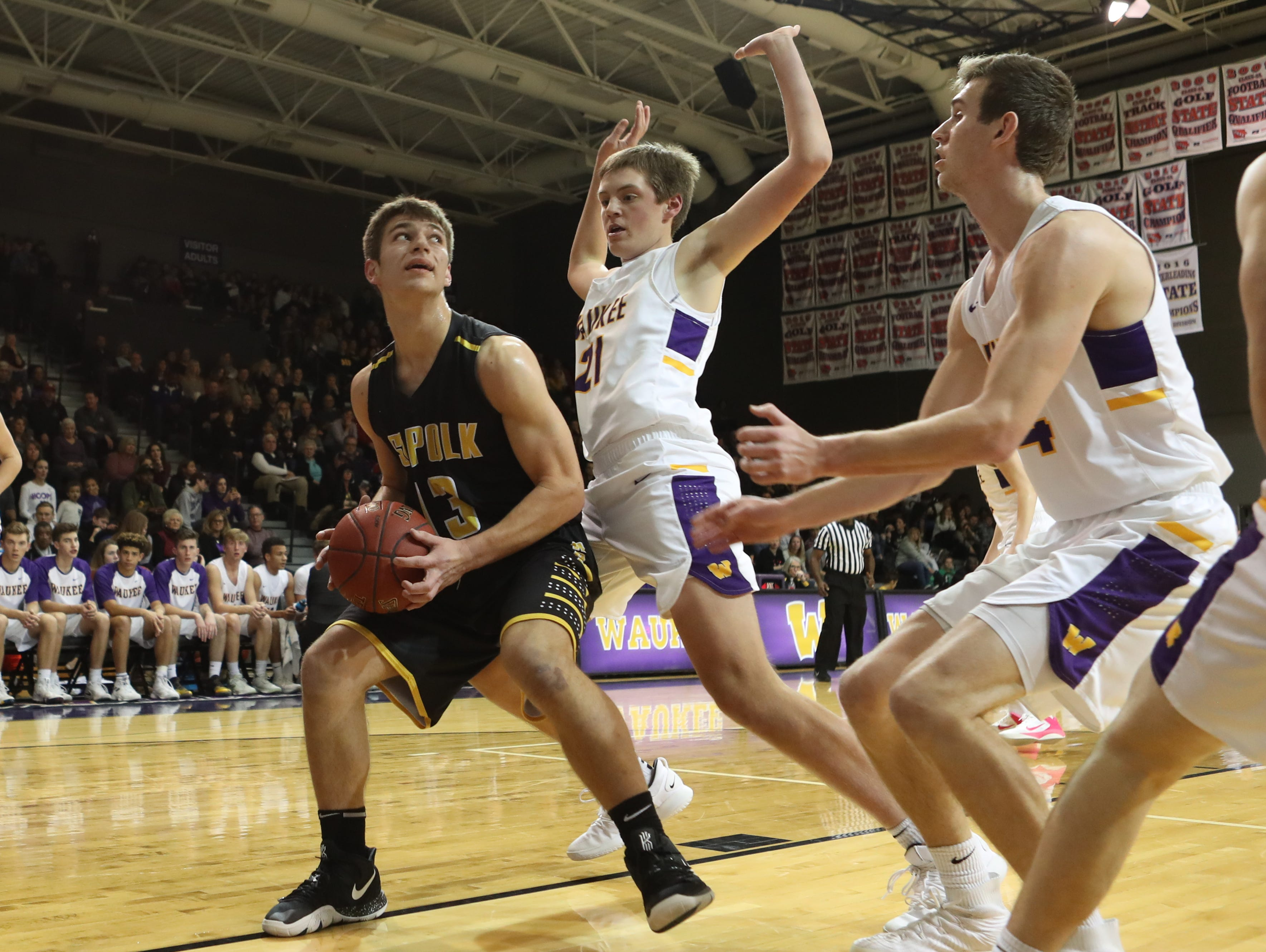 Dec 21, 2018; Waukee IA  USA; Southeast Polk Rams Dominic Caggiano (13) is pressured by Waukee Warriors Payton Sandfort (21) and Waukee Warriors Dylan Jones (4)  at Waukee High School. Mandatory Credit: Reese Strickland-for the register