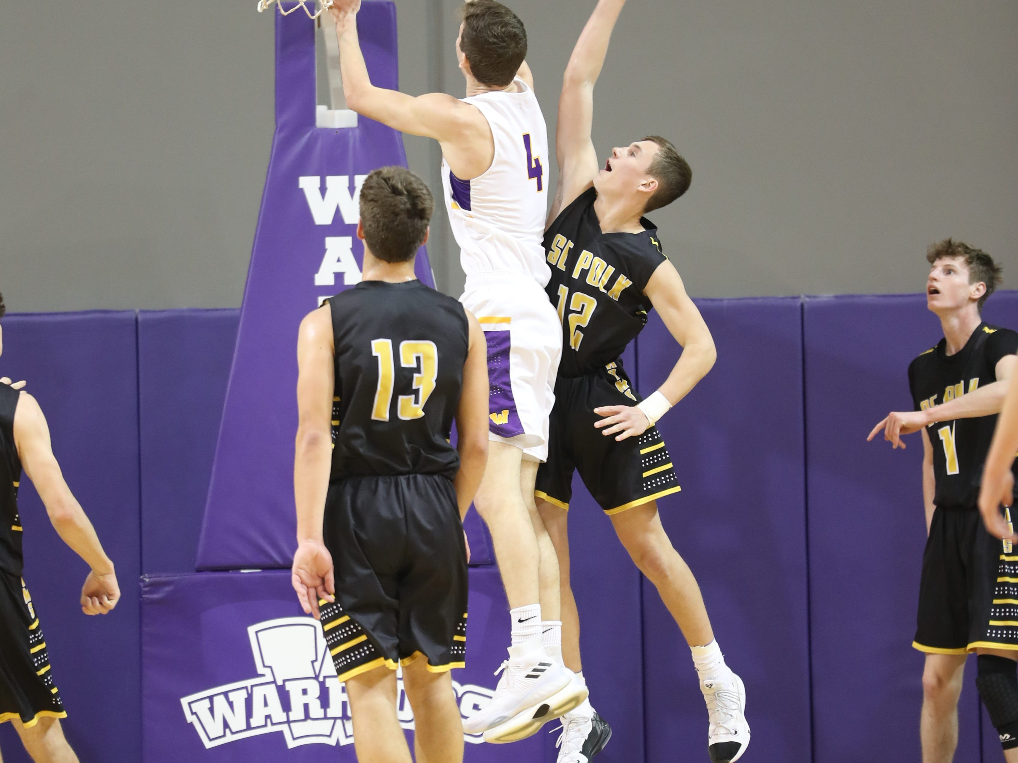 Dec 21, 2018; Waukee IA  USA; Waukee Warriors Dylan Jones (4) drives past Southeast Polk Rams Fred Johnson (12) at Waukee High School. Mandatory Credit: Reese Strickland-for the register
