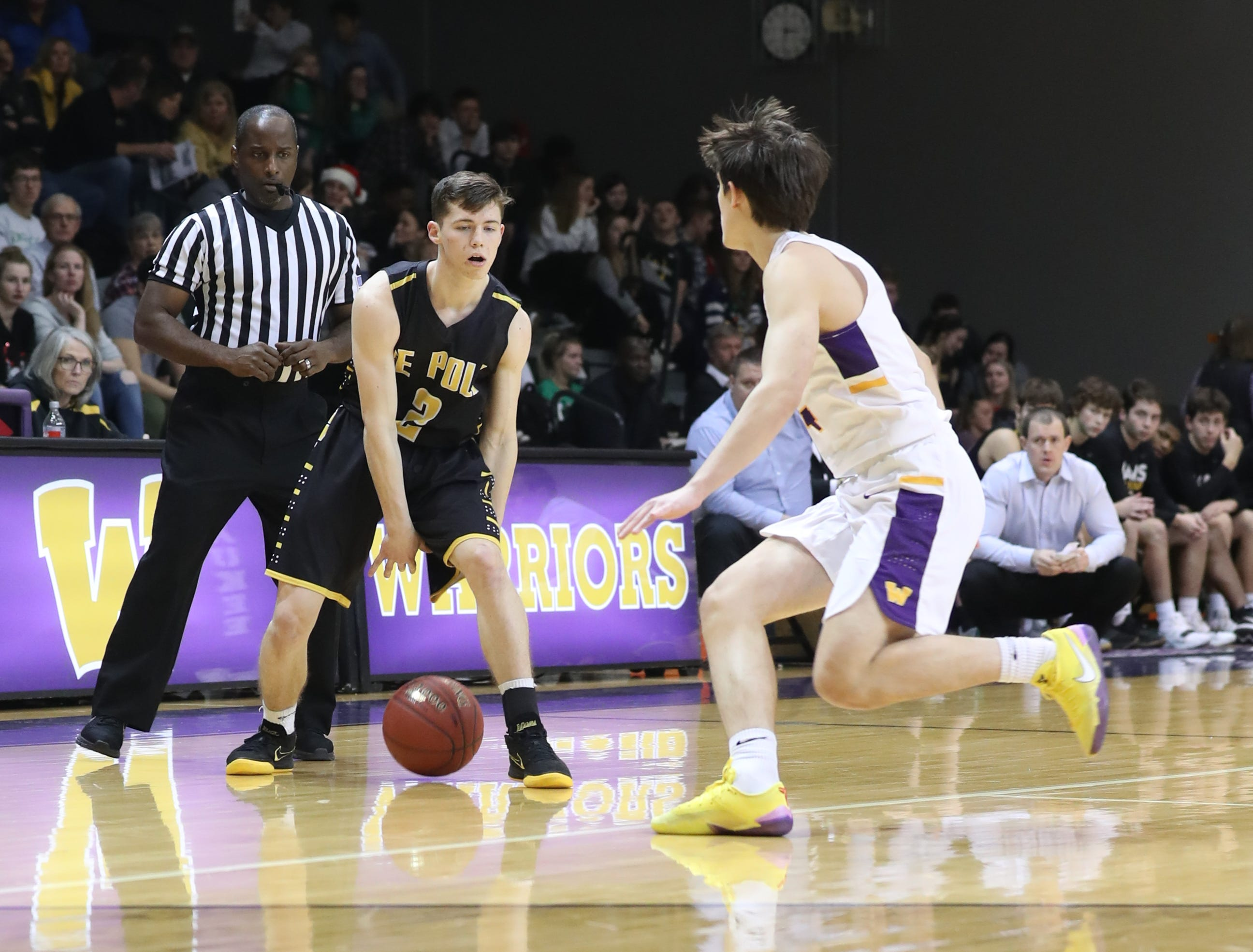 Dec 21, 2018; Waukee IA  USA; Southeast Polk Rams Eli Christiansen (2) sets the offense against the Waukee Warriors at Waukee High School. Mandatory Credit: Reese Strickland-for the register