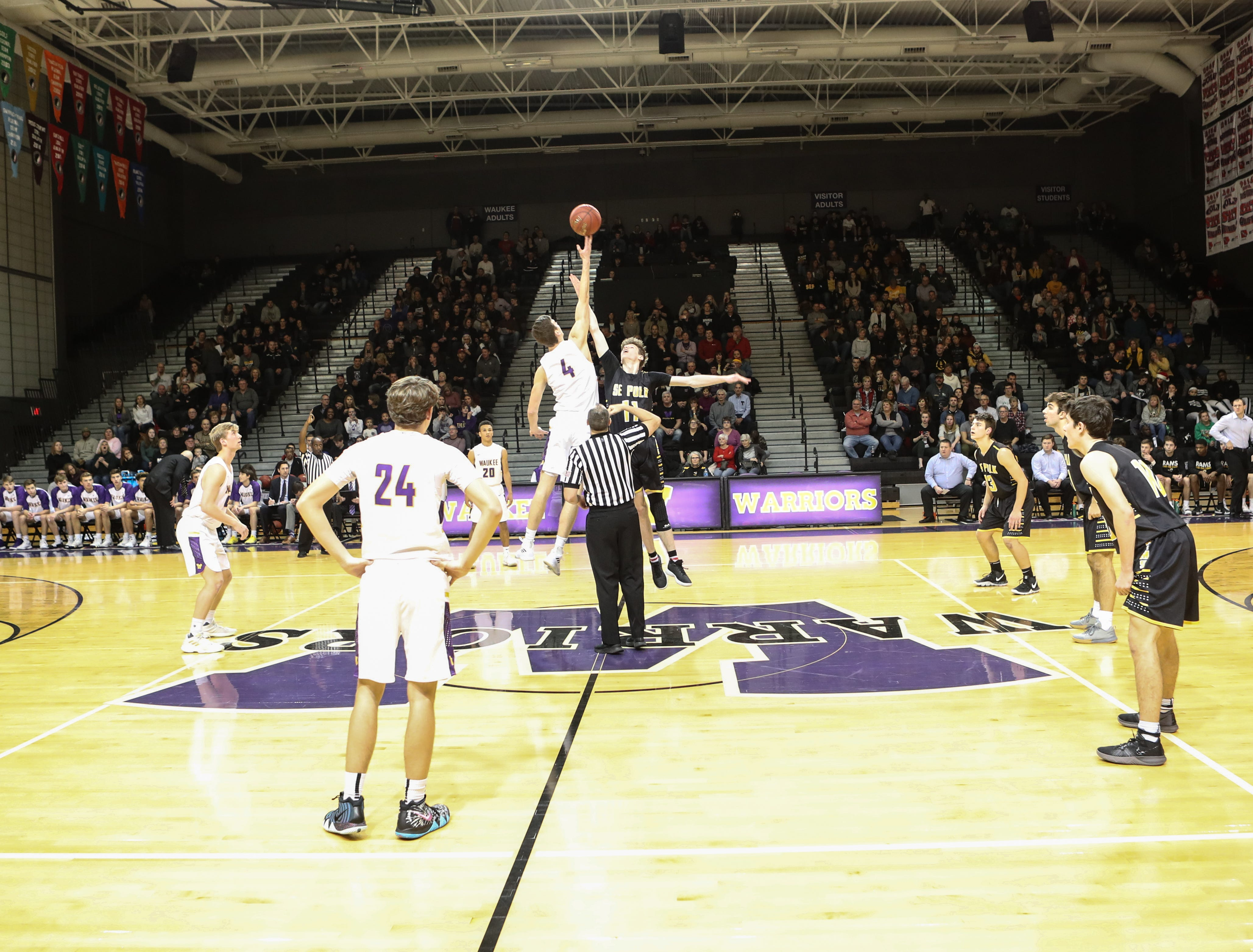 Dec 21, 2018; Waukee IA  USA; Waukee Warriors and Southeast Polk Rams jump to start the game  at Waukee High School. Mandatory Credit: Reese Strickland-for the register