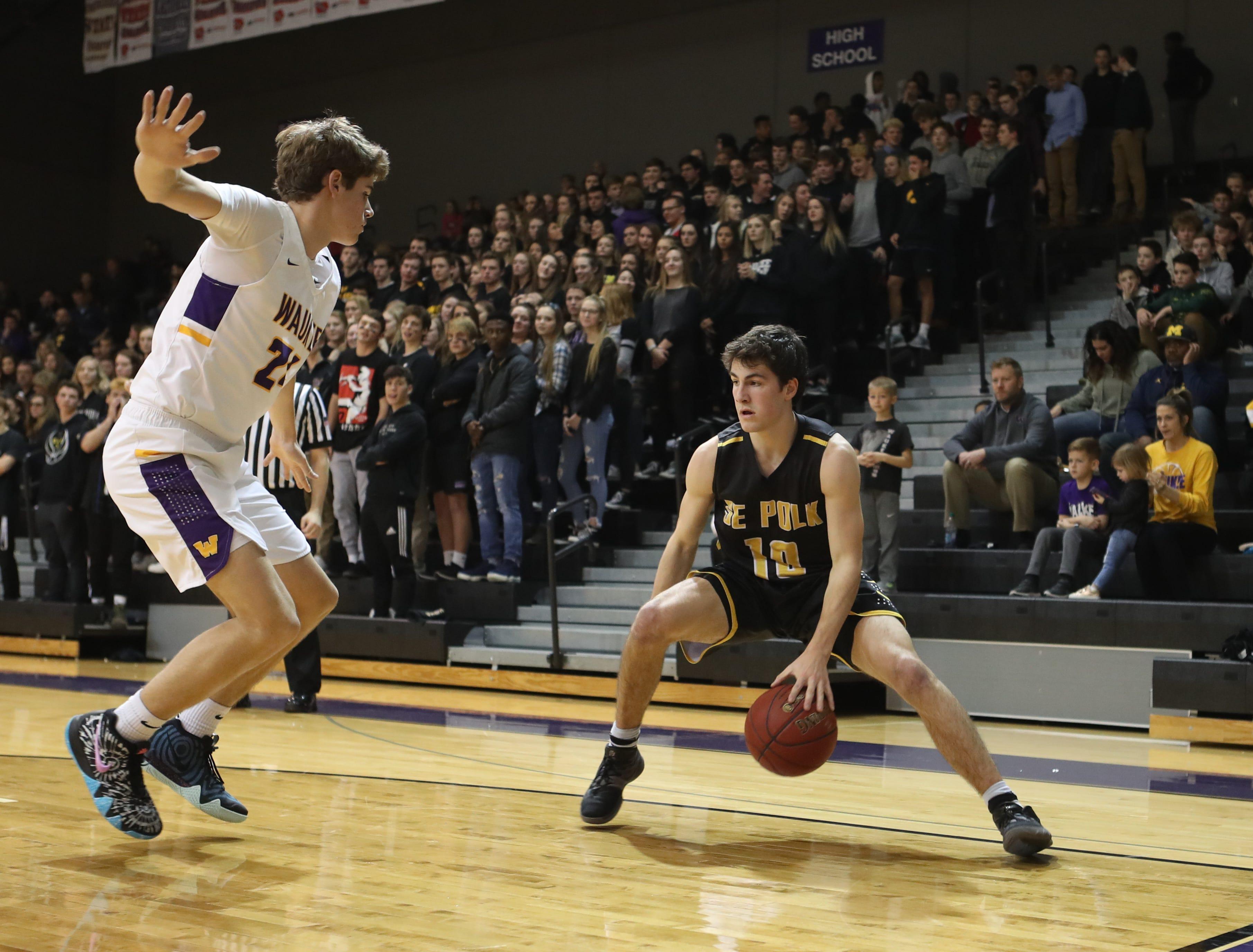 Dec 21, 2018; Waukee IA  USA; Waukee Warriors Payton Sandfort (21) defends the dribble of Southeast Polk Rams Daniel Hackbarth (10) at Waukee High School. Mandatory Credit: Reese Strickland-for the register