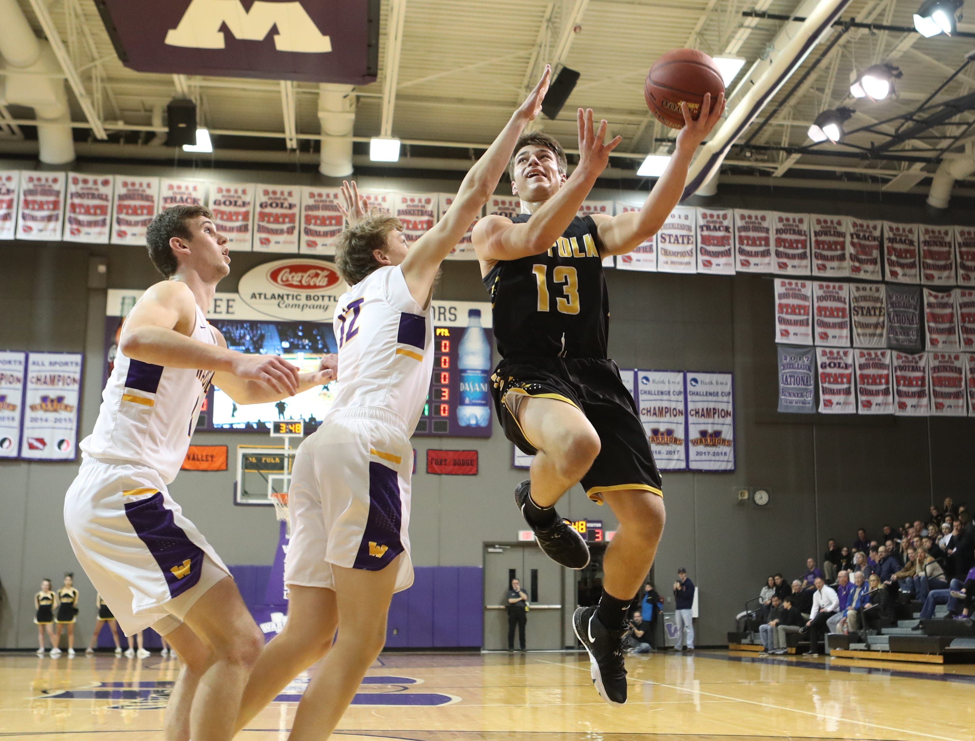 Dec 21, 2018; Waukee IA  USA;  Southeast Polk Rams Dominic Caggiano (13) shoots over the top of Waukee Warriors Tucker DeVries (12) at Waukee High School. Mandatory Credit: Reese Strickland-for the register