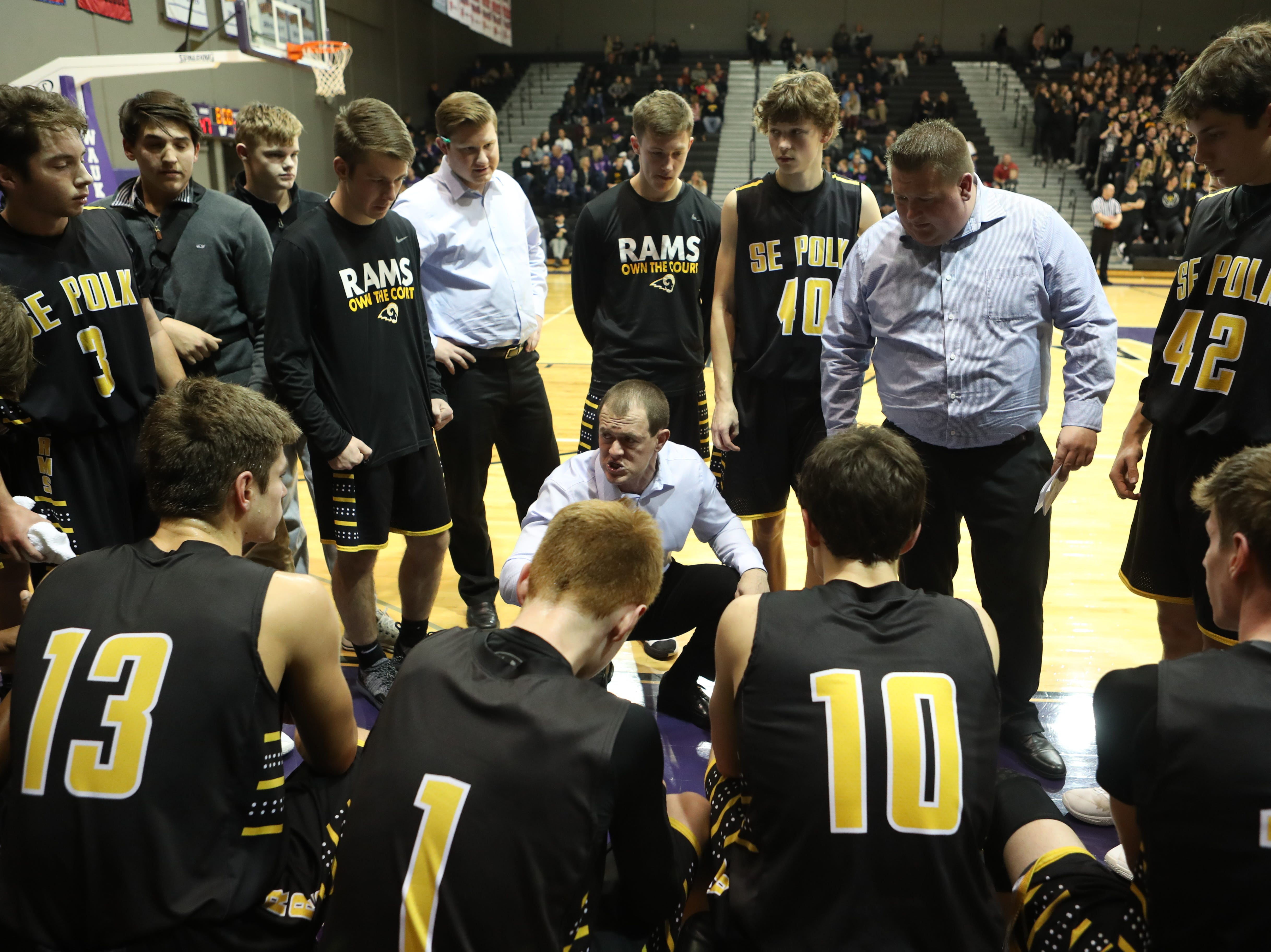 Dec 21, 2018; Waukee IA  USA; Southeast Polk Rams head coach Alan Jenkins talks to his team during their game with the Waukee Warriors at Waukee High School. Mandatory Credit: Reese Strickland-for the register
