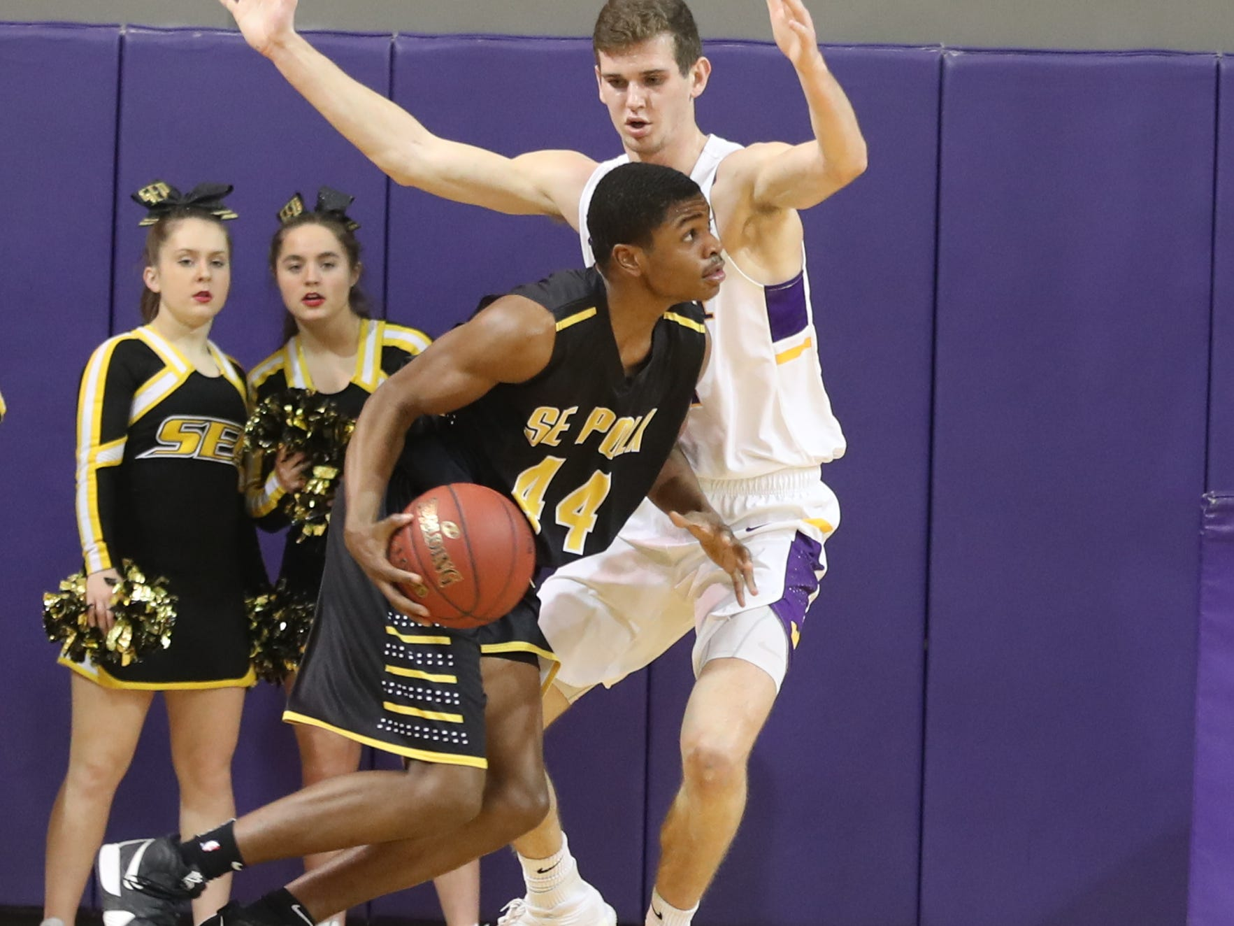 Dec 21, 2018; Waukee IA  USA;  Waukee Warriors Dylan Jones (4) defends Southeast Polk Rams Malichai Williams (44) at Waukee High School. Mandatory Credit: Reese Strickland-for the register