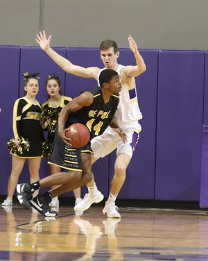 Southeast Polk's Malichai Williams drives against Waukee's Dylan Jones in a game on Dec. 21 at Waukee High School.
