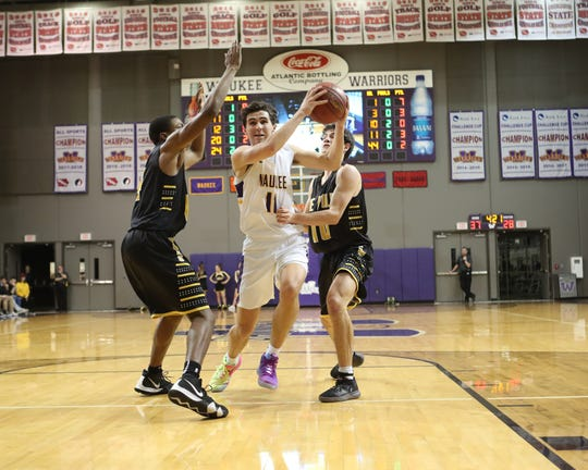 Dec 21, 2018; Waukee IA  USA;   Waukee Warriors Noah Hart (11) splits the Southeast Polk Rams defense at Waukee High School. Mandatory Credit: Reese Strickland-for the register