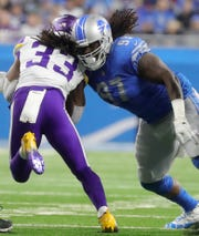 Detroit Lions defensive tackle Ricky Jean Francois tackles  Minnesota Vikings running back Dalvin Cook during the second half at Ford Field in Detroit on Sunday, December 23, 2018.