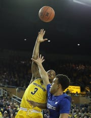 Michigan guard Zavier Simpson shoots over Air Force's Sid Tomes during the second half of U-M's 71-50 win on Saturday, Dec. 22, 2018, at Crisler Center.