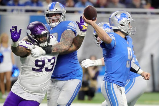 Detroit Lions quarterback Matthew Stafford is protected by Taylor Decker who is blocking Minnesota Vikings defensive tackle Sheldon Richardson during the second half at Ford Field in Detroit on Sunday, December 23, 2018.
