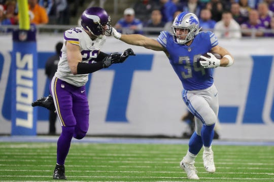 Detroit Lions running back Zach Zenner runs by Minnesota Vikings safety Harrison Smith during the first half at Ford Field in Detroit on Sunday, December 23, 2018.